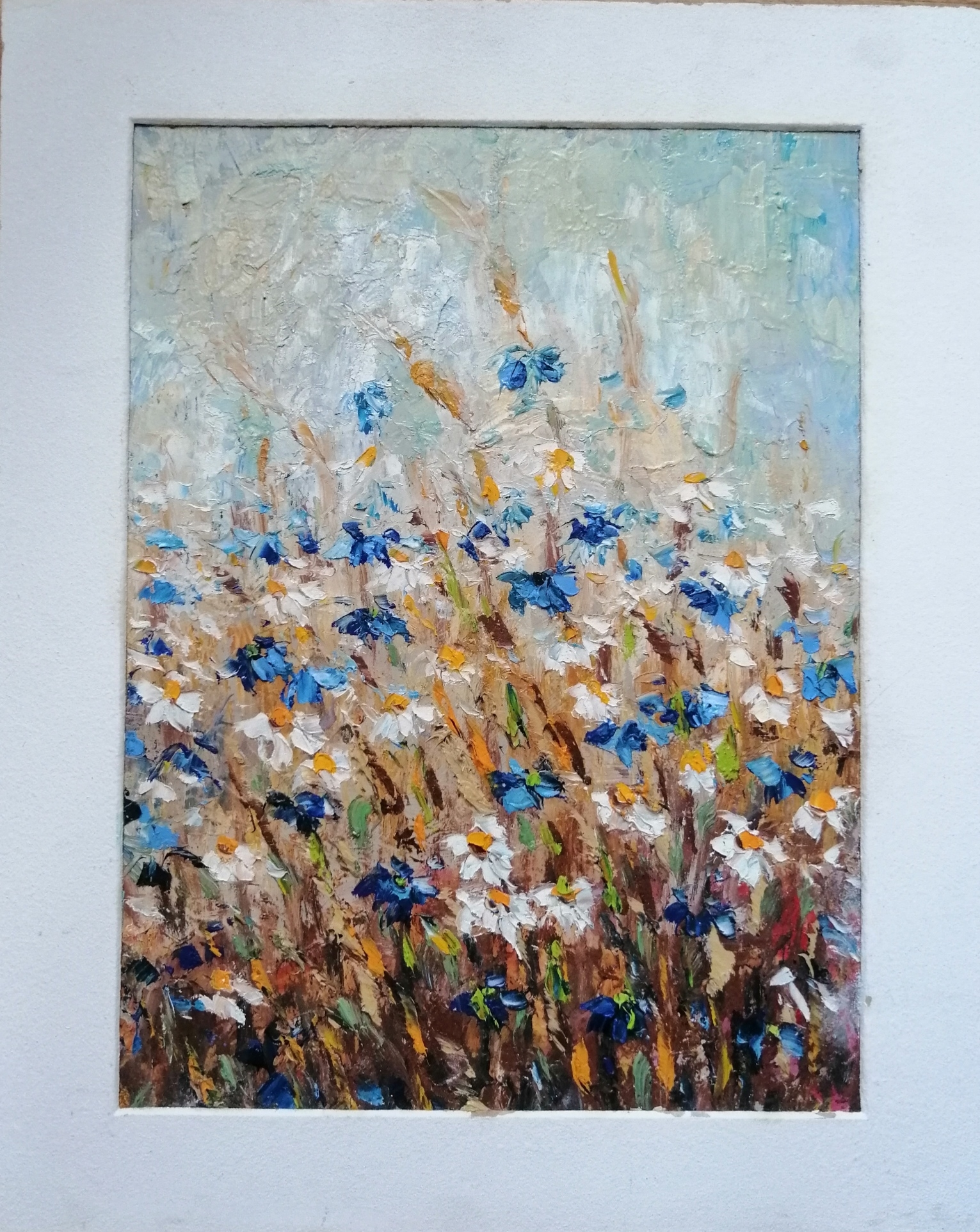 Chamomiles and cornflowers. The country flowers.