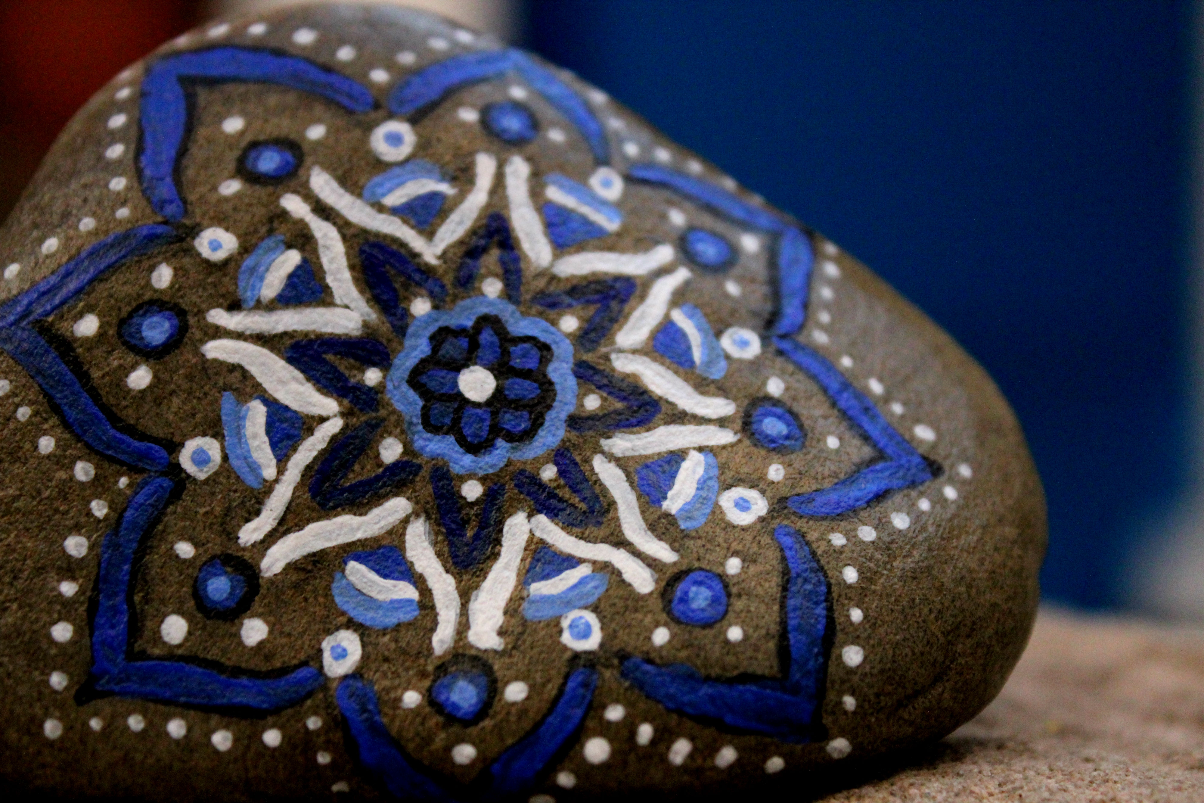Costa Brava stone painted with acrylic brush in blue tones