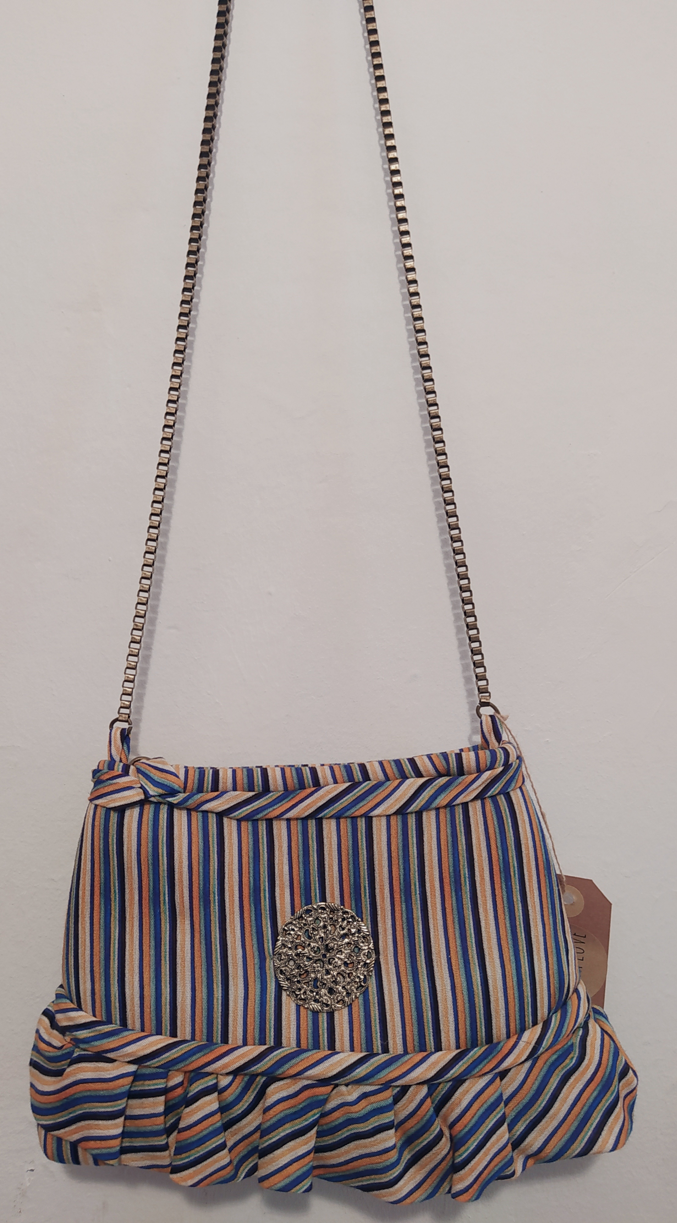 Striped bag with ruffle