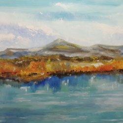 Reflejos en el lago en día de otoño