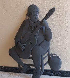 Escultura Guitarrista