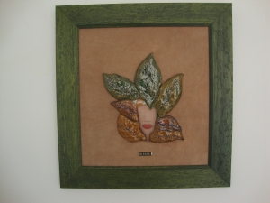 Ceramic painting, face framed fabric