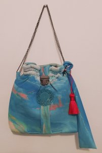 Oriental bag with red fringe