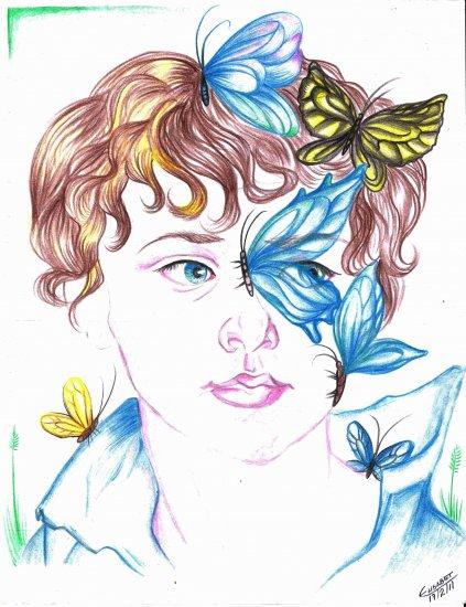 Niño con mariposas