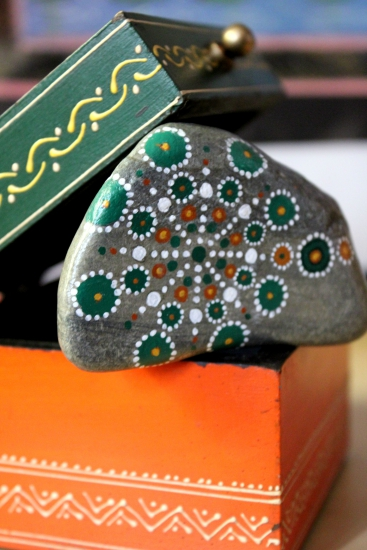 Costa Brava stone painted with acrylic brush in green and orange